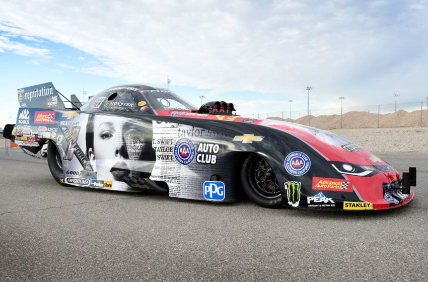 LAS VEGAS, NV - OCTOBER 30: NHRA Funny Car driver Courtney Force's Advance Auto Parts Chevrolet Camaro SS funny car is seen featuring the cover of Big Machine Records recording artist Taylor Swift's new album
