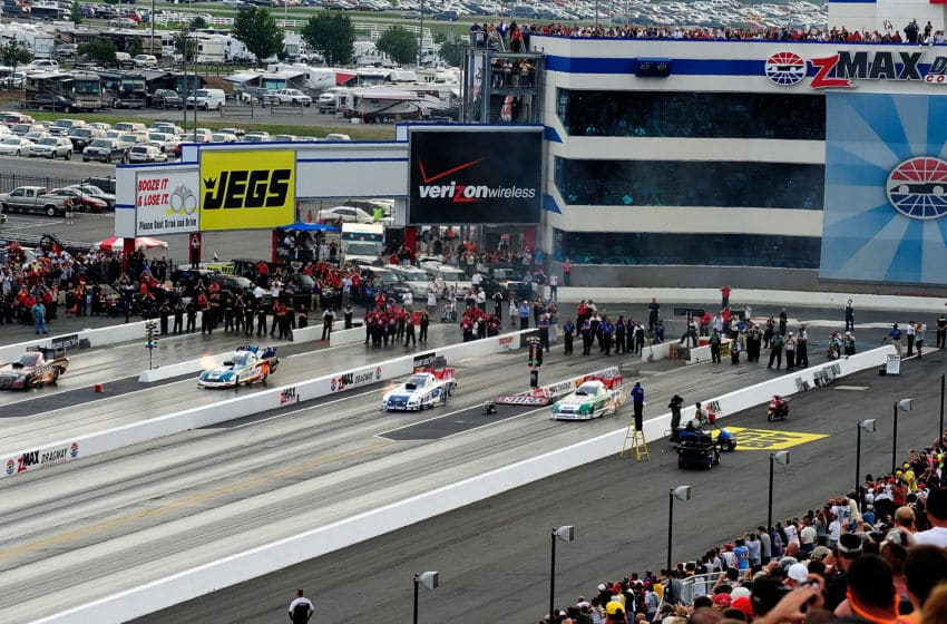 CONCORD, NC - SEPTEMBER 20: A general view of funny cars racing four wide as an exhibition during the NHRA Carolinas Nationals on September 20, 2009 at Zmax Dragway in Concord, North Carolina. (Photo by Rusty Jarrett/Getty Images)