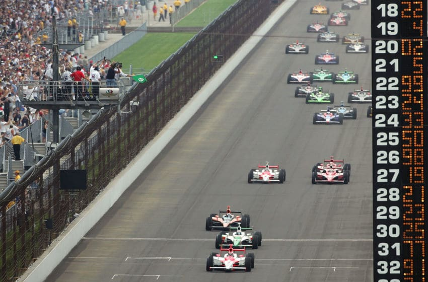 INDIANAPOLIS - MAY 27: Helio Castroneves, driver of the #3 Team Penske Dallara Honda, leads a pack of cars at the start of the IRL IndyCar Series 91st running of the Indianapolis 500 at the Indianapolis Motor Speedway on May 27, 2007 in Indianapolis, Indiana. (Photo by Robert Laberge/Getty Images)