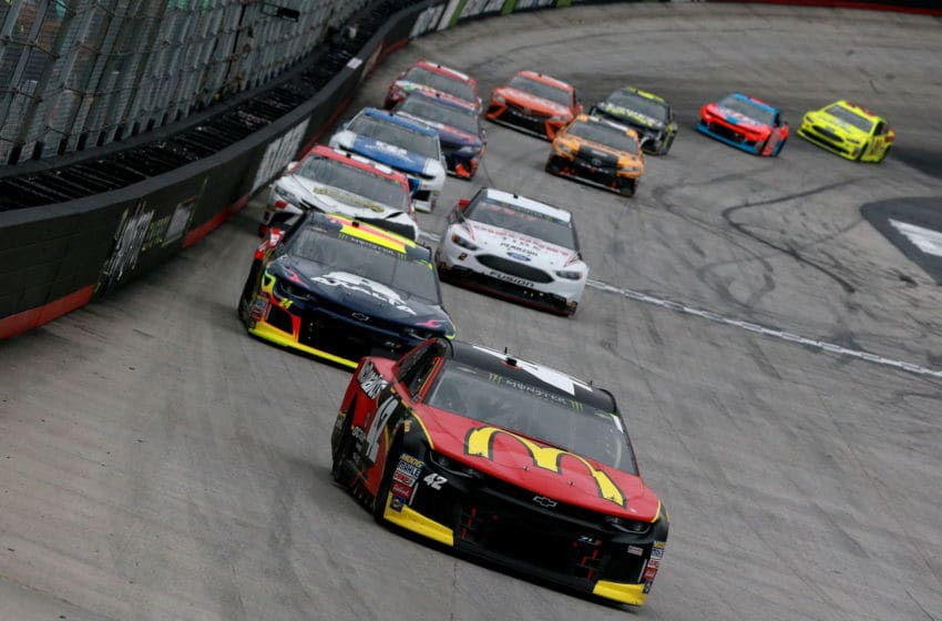 BRISTOL, TN - APRIL 15: Kyle Larson, driver of the #42 McDonald's Chevrolet, leads agroup of cars during the Monster Energy NASCAR Cup Series Food City 500 at Bristol Motor Speedway on April 15, 2018 in Bristol, Tennessee. (Photo by Sean Gardner/Getty Images)