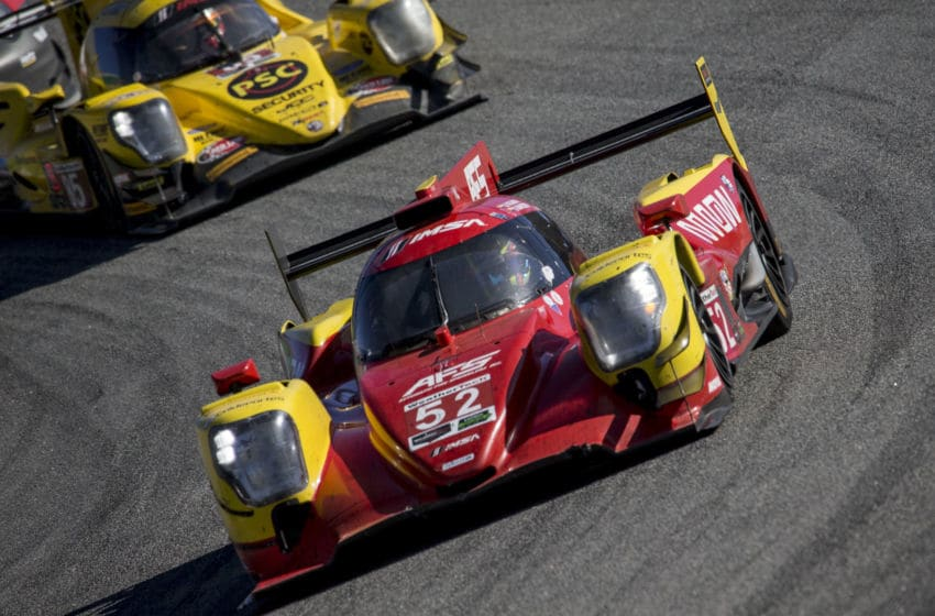 MONTEREY, CA - SEPTEMBER 09: The #52 ORECA LMP2 of Sebastian Saavedra, of Colombia, and Gustavo Yacaman, of Colombia, races on the track during the American Tire 250 IMSA WeatherTech Series race at Mazda Raceway Laguna Seca on September 9, 2018 in Monterey, California. (Photo by Brian Cleary/Getty Images)