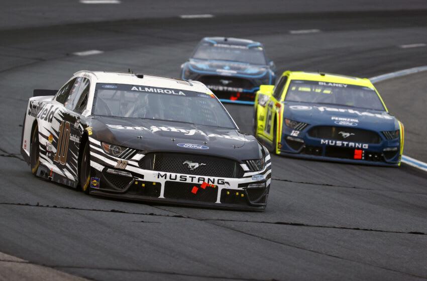 Aric Almirola, Stewart-Haas Racing, and Ryan Blaney, Team Penske, NASCAR (Photo by Jared C. Tilton/Getty Images)