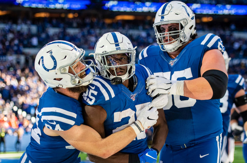 INDIANAPOLIS, IN - OCTOBER 27: Jack Doyle #84, Marlon Mack #25 and Quenton Nelson #56 of the Indianapolis Colts celebrate after Mack ran for a touchdown in the third quarter of the game against the Denver Broncos at Lucas Oil Stadium on October 27, 2019 in Indianapolis, Indiana. (Photo by Bobby Ellis/Getty Images)
