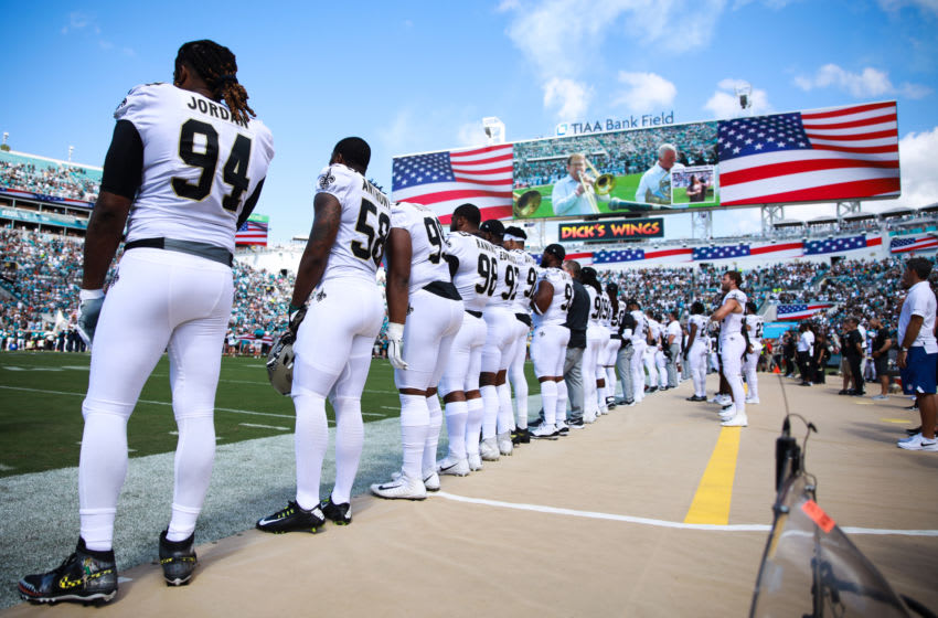 JACKSONVILLE, FLORIDA - OCTOBER 13: The New Orleans Saints standing for the national anthem before their game against the Jacksonville Jaguars at TIAA Bank Field on October 13, 2019 in Jacksonville, Florida. (Photo by Harry Aaron/Getty Images)