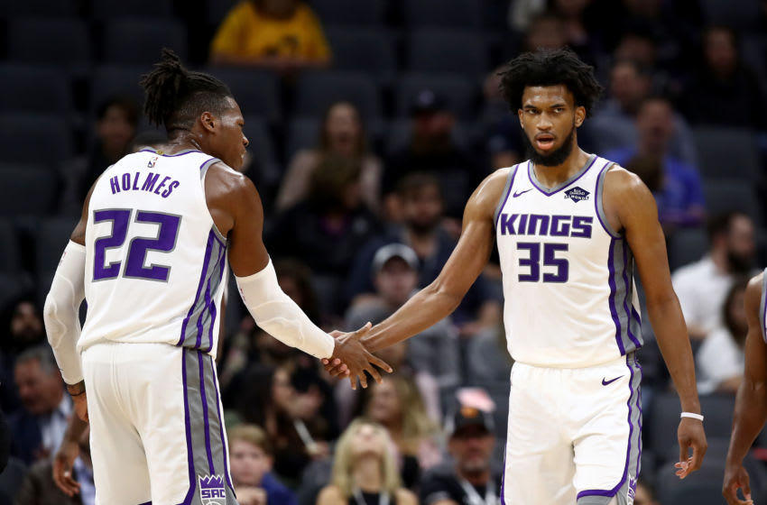 SACRAMENTO, CALIFORNIA - OCTOBER 16: Marvin Bagley III #35 of the Sacramento Kings is congratulated by Richaun Holmes #22 after he scored against the Melbourne United at Golden 1 Center on October 16, 2019 in Sacramento, California. NOTE TO USER: User expressly acknowledges and agrees that, by downloading and or using this photograph, User is consenting to the terms and conditions of the Getty Images License Agreement. (Photo by Ezra Shaw/Getty Images)
