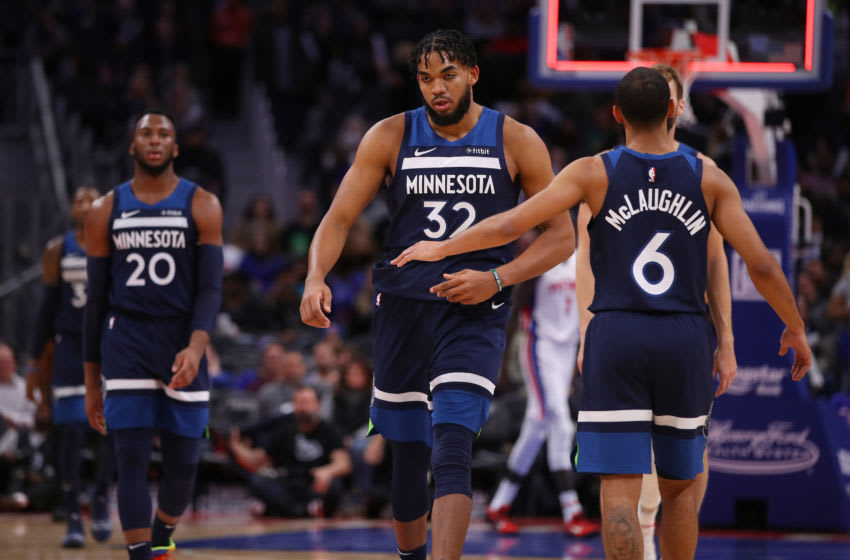 DETROIT, MICHIGAN - NOVEMBER 11: Karl-Anthony Towns #32 of the Minnesota Timberwolves celebrates a second half basket with teammates while playing the Detroit Pistons at Little Caesars Arena on November 11, 2019 in Detroit, Michigan. Minnesota won the game 120-114. NOTE TO USER: User expressly acknowledges and agrees that, by downloading and or using this photograph, User is consenting to the terms and conditions of the Getty Images License Agreement. (Photo by Gregory Shamus/Getty Images)