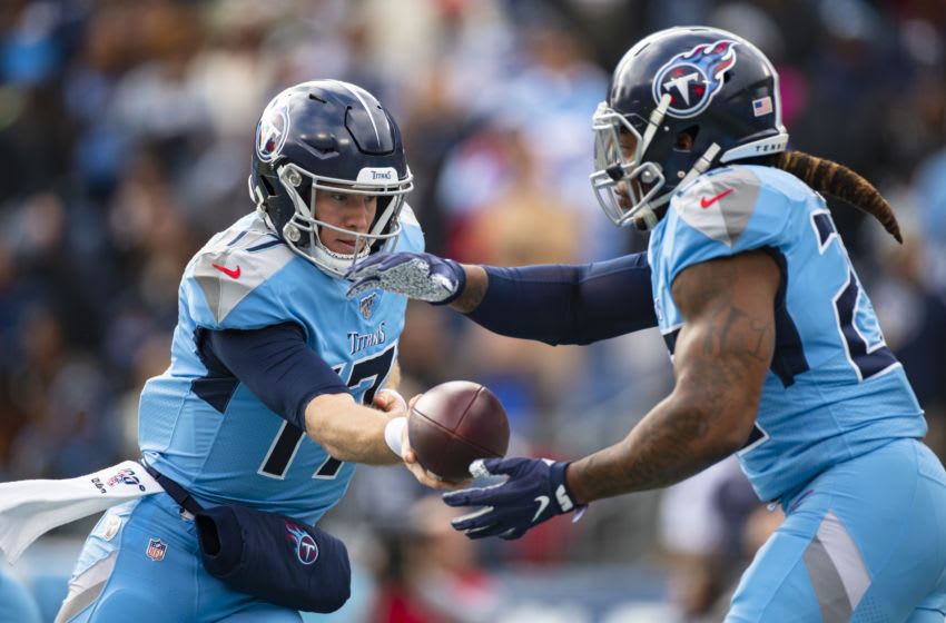 NASHVILLE, TN - DECEMBER 15: Ryan Tannehill #17 hands the ball off to Derrick Henry #22 of the Tennessee Titans during the first quarter against the Houston Texans at Nissan Stadium on December 15, 2019 in Nashville, Tennessee. (Photo by Brett Carlsen/Getty Images)