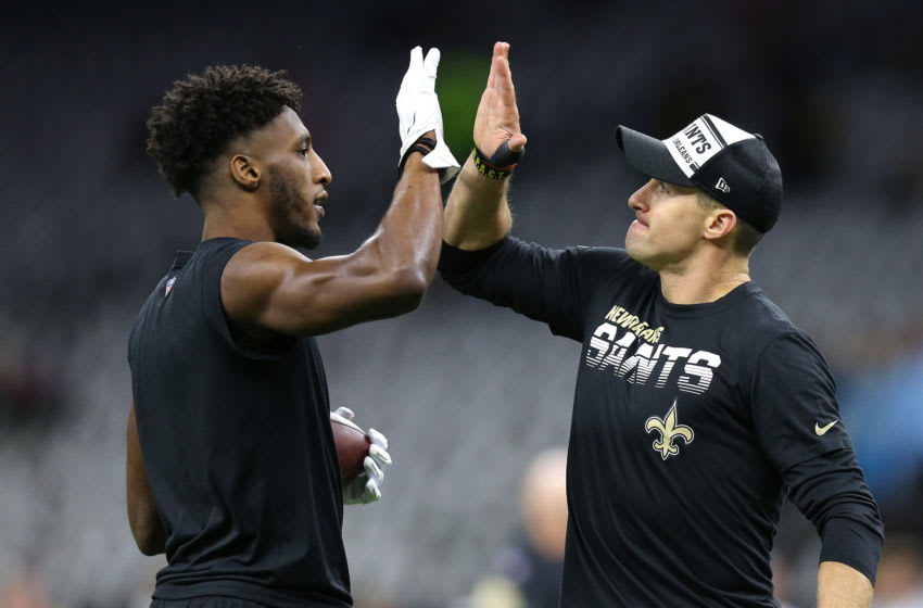 NEW ORLEANS, LOUISIANA - NOVEMBER 24: (L-R) Michael Thomas #13 high fives Drew Brees #9 of the New Orleans Saints prior to the game against the Carolina Panthers at Mercedes Benz Superdome on November 24, 2019 in New Orleans, Louisiana. (Photo by Jonathan Bachman/Getty Images)