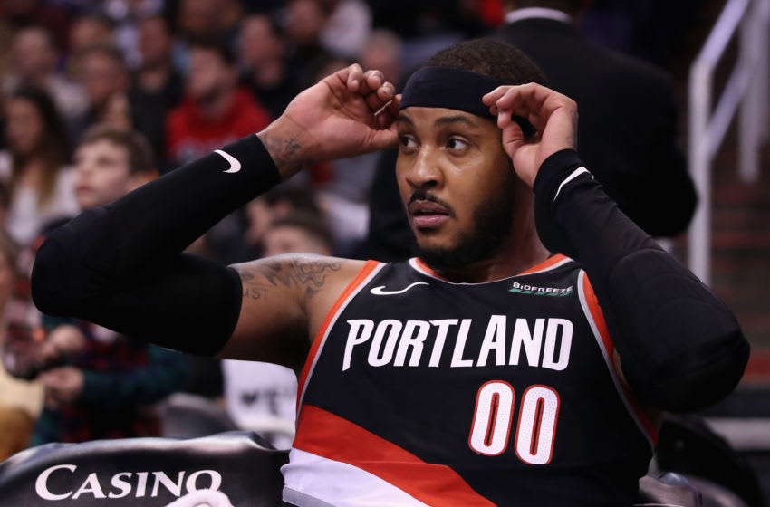 PHOENIX, ARIZONA - DECEMBER 16: Carmelo Anthony #00 of the Portland Trail Blazers sits on the bench during the first half of the NBA game against the Phoenix Suns at Talking Stick Resort Arena on December 16, 2019 in Phoenix, Arizona. NOTE TO USER: User expressly acknowledges and agrees that, by downloading and/or using this photograph, user is consenting to the terms and conditions of the Getty Images License Agreement. (Photo by Christian Petersen/Getty Images)