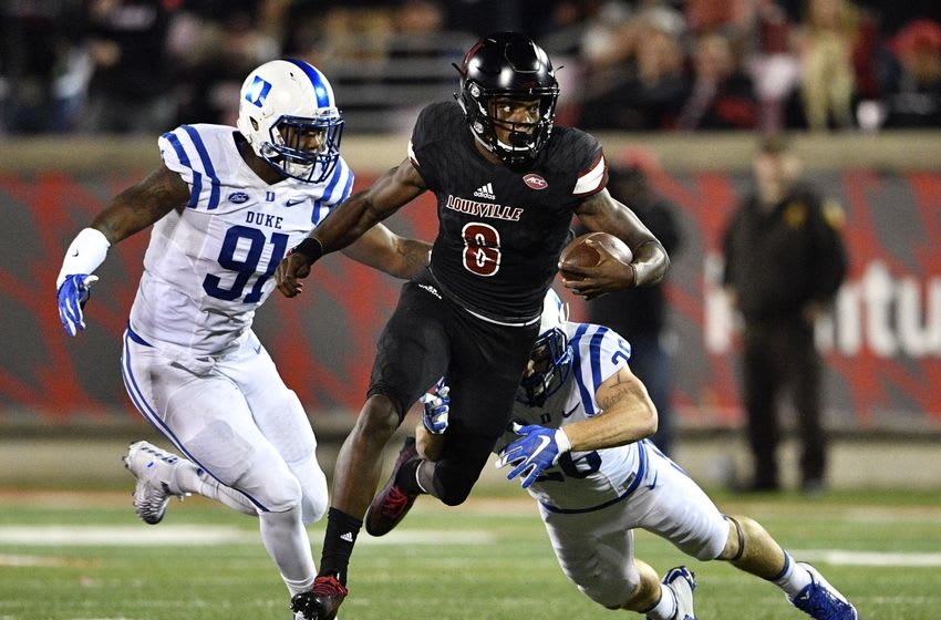 Oct 14, 2016; Louisville, KY, USA; Louisville Cardinals quarterback Lamar Jackson (8) out runs the tackles of Duke Blue Devils safety Corbin McCarthy (26) and defensive end Marquies Price (91) during the second half at Papa John