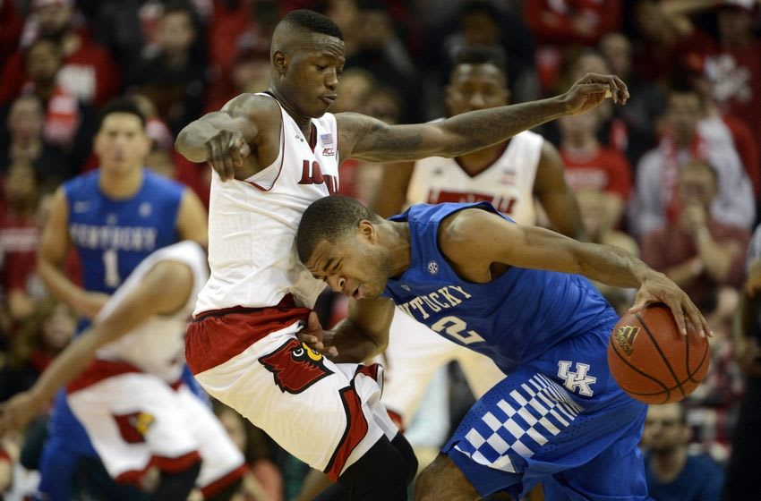Dec 27, 2014; Louisville, KY, USA; Kentucky Wildcats guard Aaron Harrison (2) dribbles against Louisville Cardinals guard Terry Rozier (0) during the second half at KFC Yum! Center. Kentucky defeated Louisville 58-50. Mandatory Credit: Jamie Rhodes-USA TODAY Sports