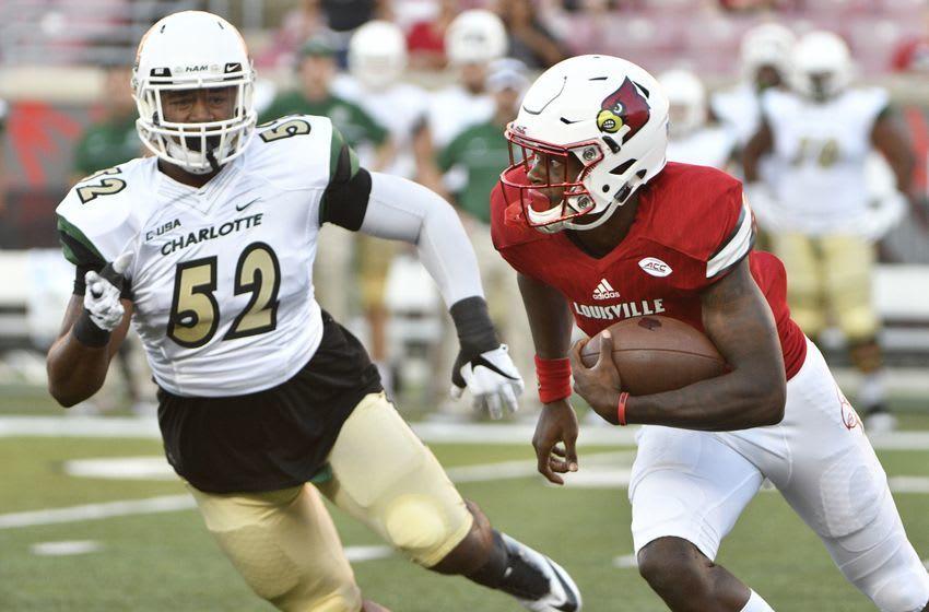 Sep 1, 2016; Louisville, KY, USA; Louisville Cardinals quarterback Lamar Jackson (8) runs the ball against Charlotte 49ers defensive lineman Zach Duncan (52) during the first quarter at Papa John