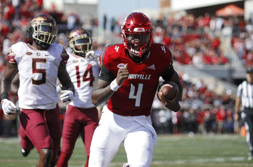 LOUISVILLE, KY - SEPTEMBER 29: Jawon Pass #4 of the Louisville Cardinals runs for a 14-yard touchdown against the Florida State Seminoles in the first quarter of the game at Cardinal Stadium on September 29, 2018 in Louisville, Kentucky. (Photo by Joe Robbins/Getty Images)