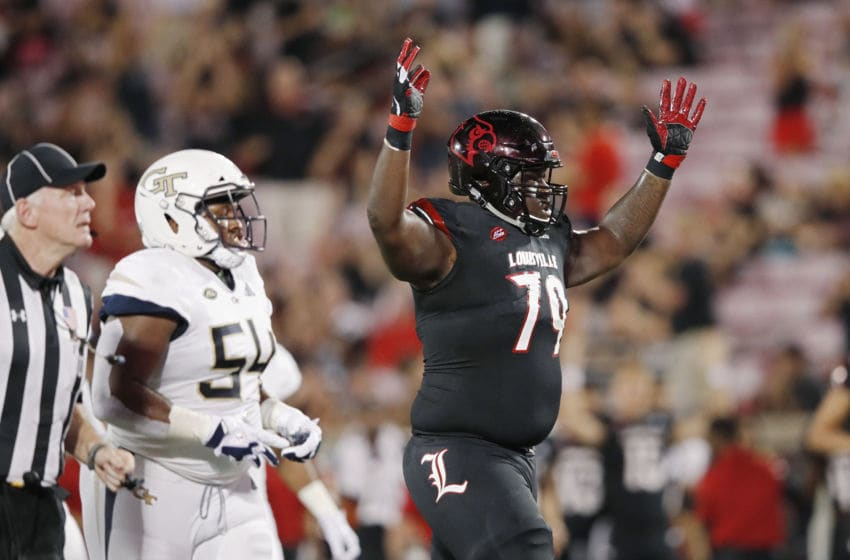 LOUISVILLE, KY - OCTOBER 05: Kenny Thomas #79 of the Louisville Cardinals celebrates after a touchdown in the first half of the game against the Georgia Tech Yellow Jackets at Cardinal Stadium on October 5, 2018 in Louisville, Kentucky. (Photo by Joe Robbins/Getty Images)