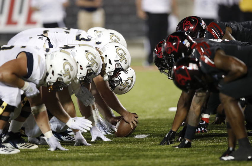 LOUISVILLE, KY - OCTOBER 05: Georgia Tech Yellow Jackets face off at the line of scrimmage against the Louisville Cardinals during the game at Cardinal Stadium on October 5, 2018 in Louisville, Kentucky. Georgia Tech won 66-31. (Photo by Joe Robbins/Getty Images)
