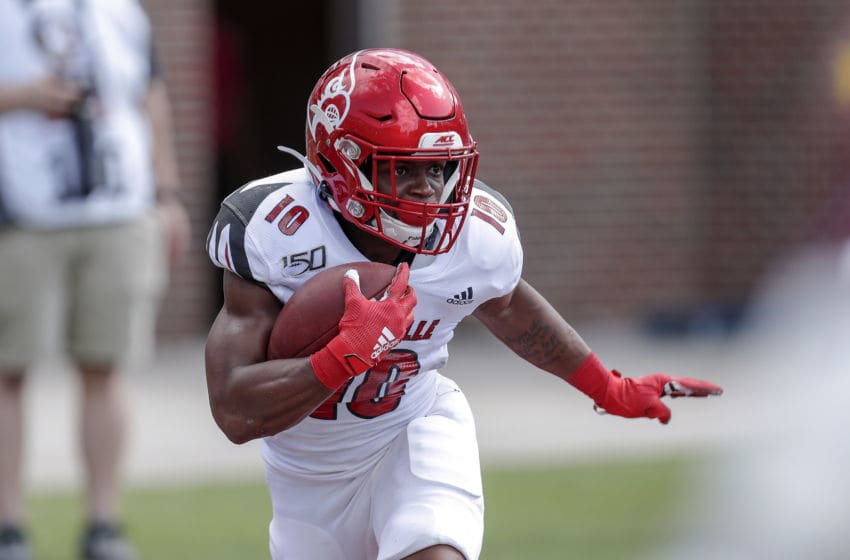 TALLAHASSEE, FL - SEPTEMBER 21: Linebacker Rodjay Burns #10 of the Louisville Cardinals runs a punt return during the game against the Florida State Seminoles at Doak Campbell Stadium on Bobby Bowden Field on September 21, 2019 in Tallahassee, Florida. The Seminoles defeated the Cardinals 35 to 24. (Photo by Don Juan Moore/Getty Images)