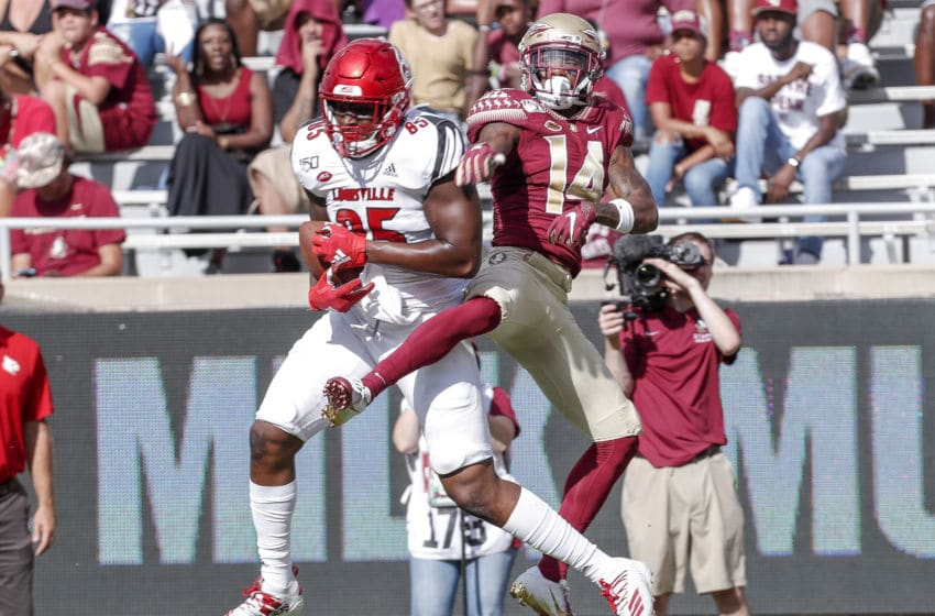 TALLAHASSEE, FL - SEPTEMBER 21: Tight End Jordan Davis #85 of the Louisville Cardinals makes a catch over Cornerback Kyle Meyers #14 of the Florida State Seminoles during the game at Doak Campbell Stadium on Bobby Bowden Field on September 21, 2019 in Tallahassee, Florida. The Seminoles defeated the Cardinals 35 to 24. (Photo by Don Juan Moore/Getty Images)