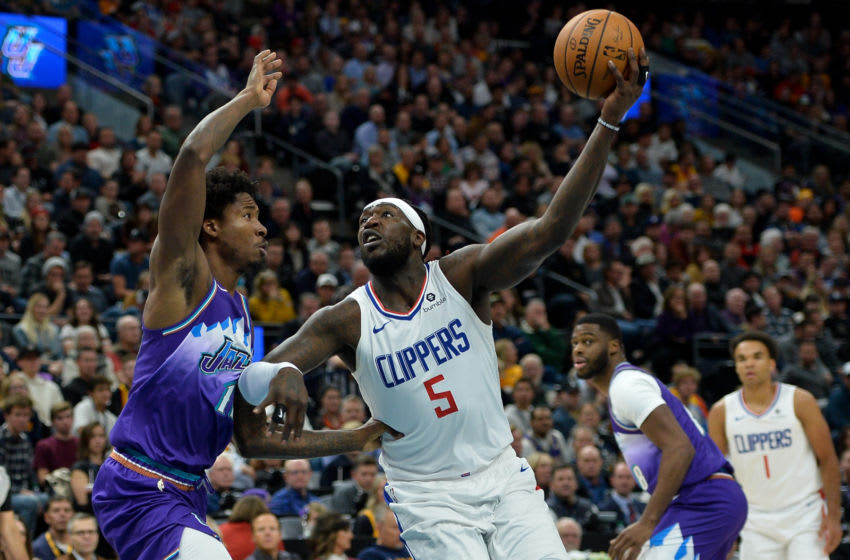 SALT LAKE CITY, UT - OCTOBER 30: Montrezl Harrell #5 of the LA Clippers shoots over Ed Davis #17 of the Utah Jazz during a game at Vivint Smart Home Arena on October 30, 2019 in Salt Lake City, Utah. NOTE TO USER: User expressly acknowledges and agrees that, by downloading and or using this photograph, User is consenting to the terms and conditions of the Getty Images License Agreement. (Photo by Alex Goodlett/Getty Images)