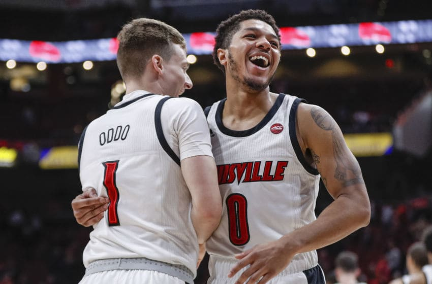 LOUISVILLE, KY - NOVEMBER 17: Keith Oddo #1 and Lamarr Kimble #0 of the Louisville Basketball Cardinals celebrate following the game against the North Carolina Central Eagles at KFC YUM! Center on November 17, 2019 in Louisville, Kentucky. (Photo by Michael Hickey/Getty Images)