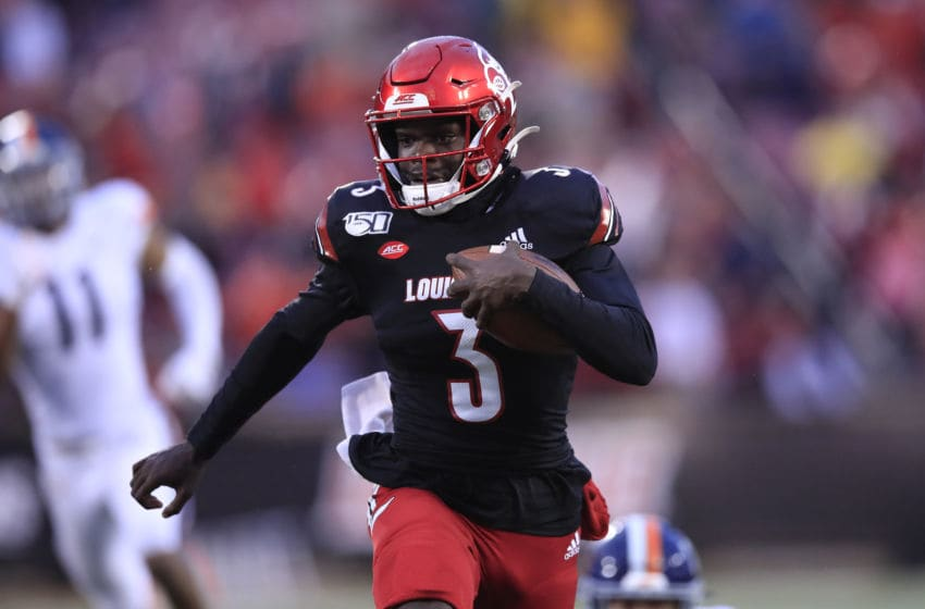 LOUISVILLE, KENTUCKY - OCTOBER 26: Micale Cunningham #3 of the Louisville Cardinals runs for a touchdown against the Virginia Cavaliers on October 26, 2019 in Louisville, Kentucky. (Photo by Andy Lyons/Getty Images)