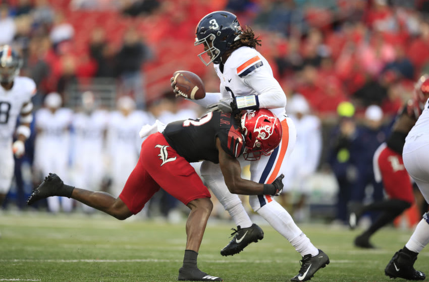 Marlon Character #12 of the Louisville Cardinals sacks Bryce Perkins #3 of the Virginia Cavaliers (Photo by Andy Lyons/Getty Images)