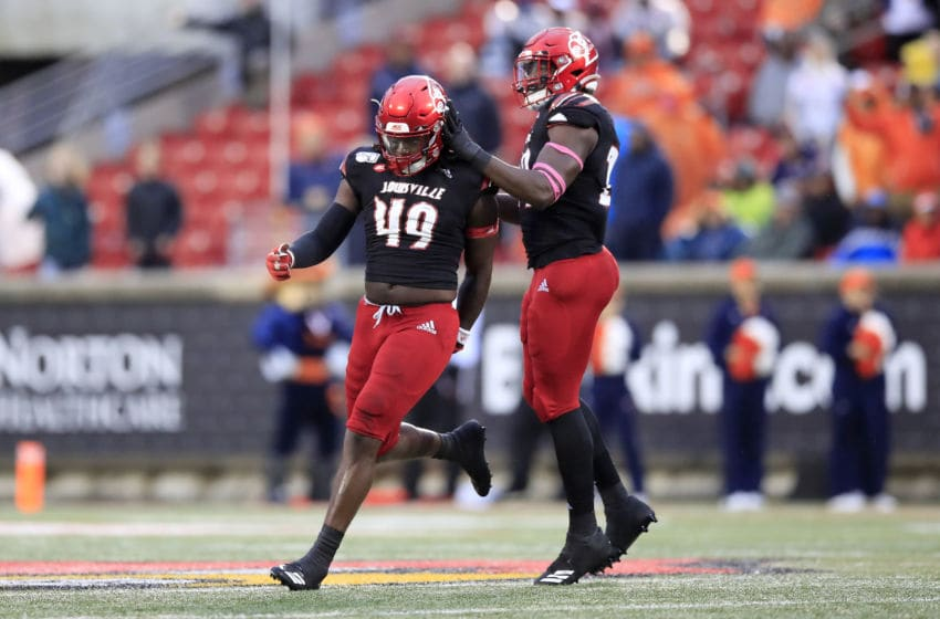 LOUISVILLE, KENTUCKY - OCTOBER 26: Boosie Whitlow #49 and Tabarius Peterson #29 of the Louisville Cardinals celebrate during the game against the Virginia Cavaliers on October 26, 2019 in Louisville, Kentucky. (Photo by Andy Lyons/Getty Images)