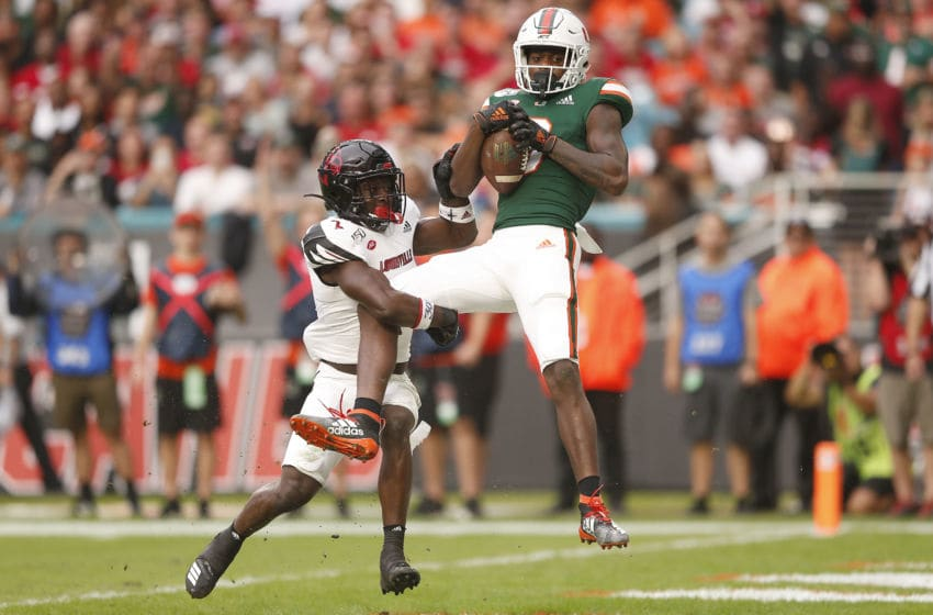 MIAMI, FLORIDA - NOVEMBER 09: Dee Wiggins #8 of the Miami Hurricanes catches a touchdown pass against the Louisville Cardinals during the first half at Hard Rock Stadium on November 09, 2019 in Miami, Florida. (Photo by Michael Reaves/Getty Images)
