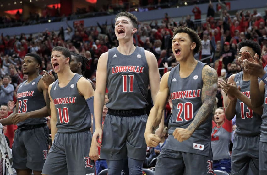 LOUISVILLE, KENTUCKY - DECEMBER 06: Samuell Wiliiamson #10, Quinn Slazinski #11 and Josh Nickelberry #20 of the Louisville Cardinals celebrate during the game against the Pittsburgh Panthers at KFC YUM! Center on December 06, 2019 in Louisville, Kentucky. (Photo by Andy Lyons/Getty Images)