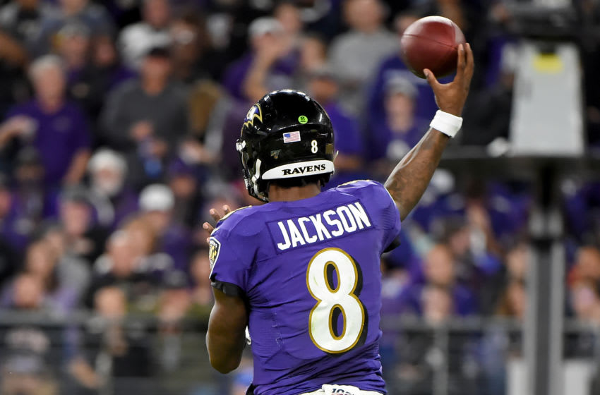 BALTIMORE, MARYLAND - JANUARY 11: Lamar Jackson #8 of the Baltimore Ravens throws against the Tennessee Titans during the AFC Divisional Playoff game at M&T Bank Stadium on January 11, 2020 in Baltimore, Maryland. (Photo by Will Newton/Getty Images)