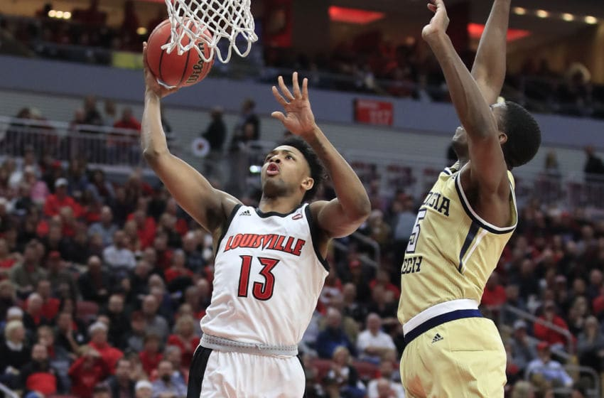 LOUISVILLE, KENTUCKY - JANUARY 22: David Johnson #13 of the Louisville Cardinals shoots the ball against the Georgia Tech Yellow Jackets at KFC YUM! Center on January 22, 2020 in Louisville, Kentucky. (Photo by Andy Lyons/Getty Images)