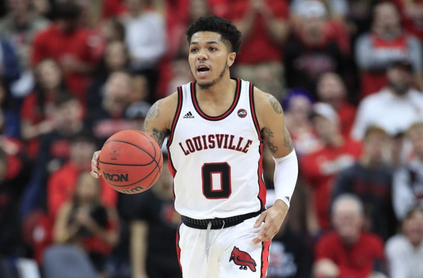 LOUISVILLE, KENTUCKY - JANUARY 25: Lamarr Kimble #0 of the Louisville Cardinals dribbles the ball against the Clemson Tigers at KFC YUM! Center on January 25, 2020 in Louisville, Kentucky. (Photo by Andy Lyons/Getty Images)