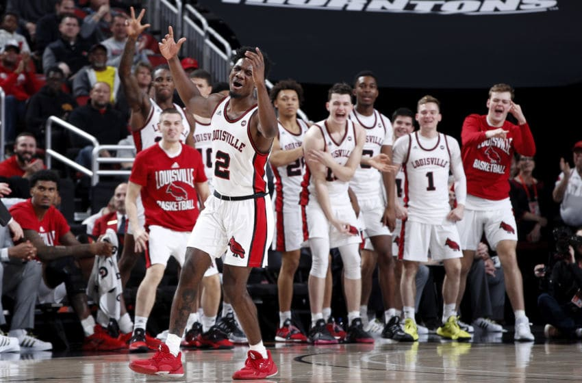 LOUISVILLE, KY - JANUARY 25: Darius Perry #2 of the Louisville Cardinals reacts after hitting a three-point basket against the Clemson Tigers in the first half of a game at KFC YUM! Center on January 25, 2020 in Louisville, Kentucky. Louisville defeated Clemson 80-62. (Photo by Joe Robbins/Getty Images)