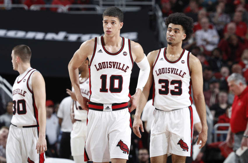 LOUISVILLE, KY - JANUARY 25: Samuell Williamson #10 and Jordan Nwora #33 of the Louisville Cardinals look on during a game against the Clemson Tigers at KFC YUM! Center on January 25, 2020 in Louisville, Kentucky. Louisville defeated Clemson 80-62. (Photo by Joe Robbins/Getty Images)