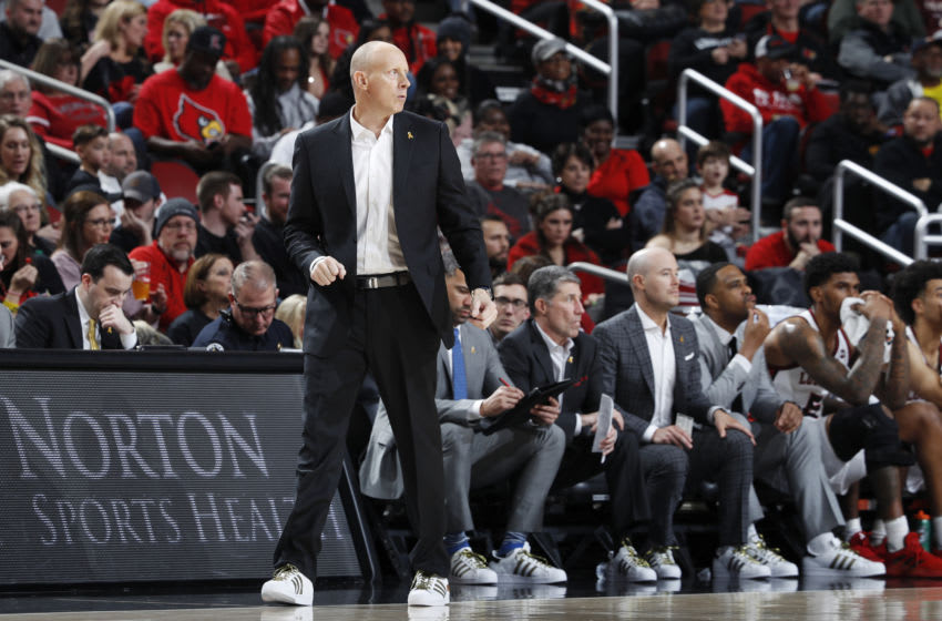 LOUISVILLE, KY - JANUARY 25: Head coach Chris Mack of the Louisville Cardinals looks on along with his staff on the bench during a game against the Clemson Tigers at KFC YUM! Center on January 25, 2020 in Louisville, Kentucky. Louisville defeated Clemson 80-62. (Photo by Joe Robbins/Getty Images)