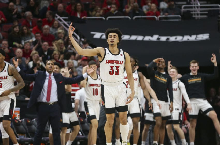 LOUISVILLE, KENTUCKY - FEBRUARY 08: Jordan Nwora #33 of the Louisville Cardinals celebrates after making a three-point shot against the Virginia Cavaliers during the first half of the game at KFC YUM! Center on February 08, 2020 in Louisville, Kentucky. (Photo by Silas Walker/Getty Images)