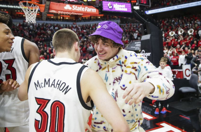 LOUISVILLE, KENTUCKY - FEBRUARY 08: Louisville recording artist Jack Harlow celebrates with Ryan McMahon #30 of the Louisville Cardinals after they defeated the Virginia Cavaliers 80-73 at KFC YUM! Center on February 08, 2020 in Louisville, Kentucky. (Photo by Silas Walker/Getty Images)