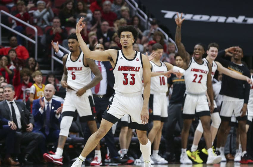 LOUISVILLE, KENTUCKY - FEBRUARY 08: Jordan Nwora #33 of the Louisville basketball program celebrates making a three point shot against the Virginia Cavaliers during the first half of the game at KFC YUM! Center on February 08, 2020 in Louisville, Kentucky. (Photo by Silas Walker/Getty Images)