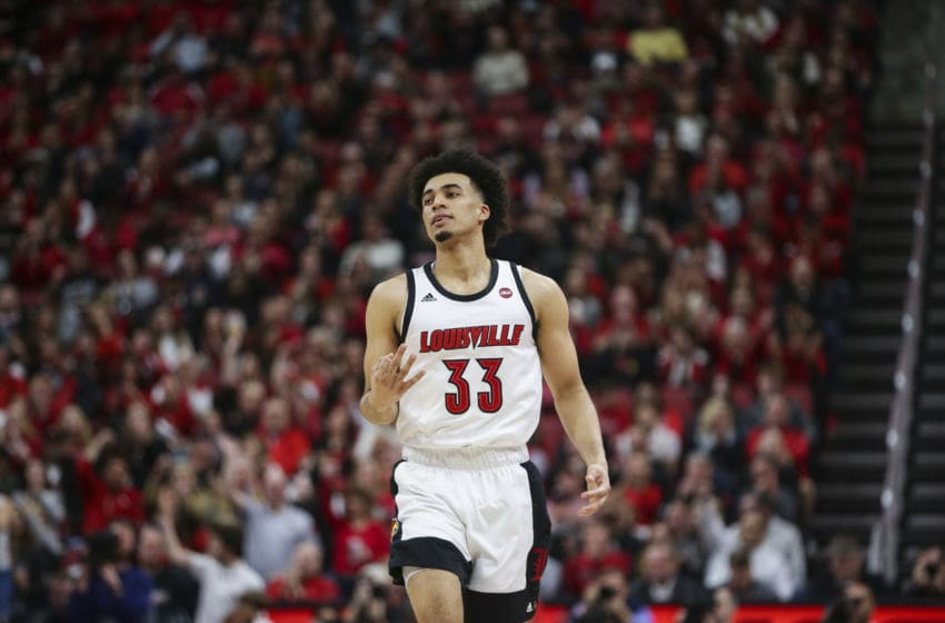 LOUISVILLE, KENTUCKY - FEBRUARY 08: Jordan Nwora #33 of the Louisville Cardinals celebrates making a three point shot against the Virginia Cavaliers during the first half of the game at KFC YUM! Center on February 08, 2020 in Louisville, Kentucky. (Photo by Silas Walker/Getty Images)