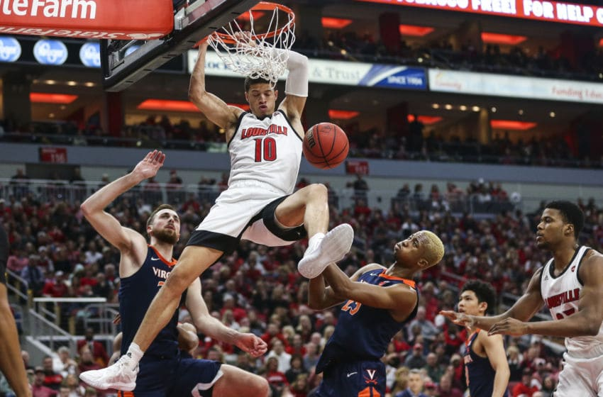 LOUISVILLE, KENTUCKY - FEBRUARY 08: Samuell Williamson #10 of the Louisville Cardinals dunks the ball against the Virginia Cavaliers during the first half of the game at KFC YUM! Center on February 08, 2020 in Louisville, Kentucky. (Photo by Silas Walker/Getty Images)