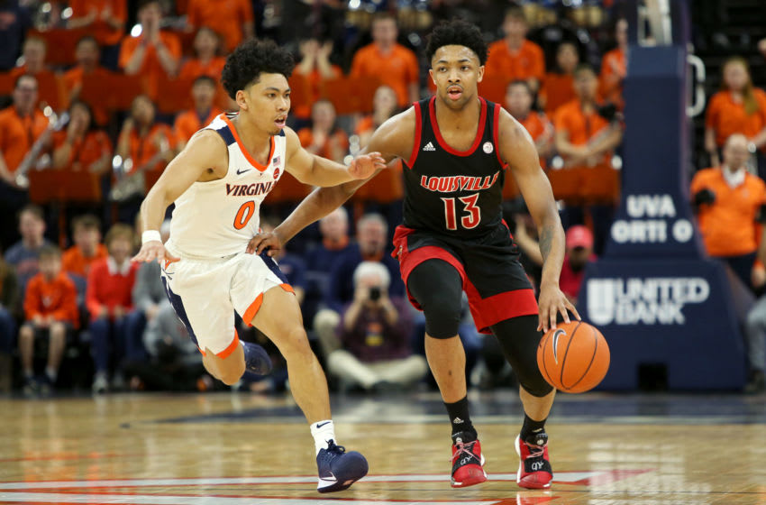 David Johnson #13 of the Louisville Cardinals drives past Kihei Clark #0 of the Virginia Cavaliers (Photo by Ryan M. Kelly/Getty Images)
