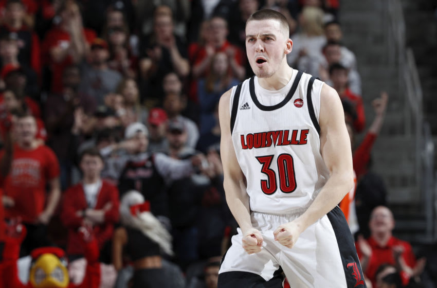 LOUISVILLE, KY - FEBRUARY 19: Ryan McMahon #30 of the Louisville Cardinals reacts after hitting a three-point basket against the Syracuse Orange in the first half of a game at KFC YUM! Center on February 19, 2020 in Louisville, Kentucky. (Photo by Joe Robbins/Getty Images)