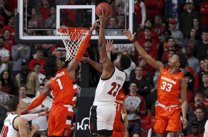 LOUISVILLE, KY - FEBRUARY 19: Quincy Guerrier #1 and Elijah Hughes #33 of the Syracuse Orange defend against Steven Enoch #23 of the Louisville Cardinals in the first half of a game at KFC YUM! Center on February 19, 2020 in Louisville, Kentucky. (Photo by Joe Robbins/Getty Images)