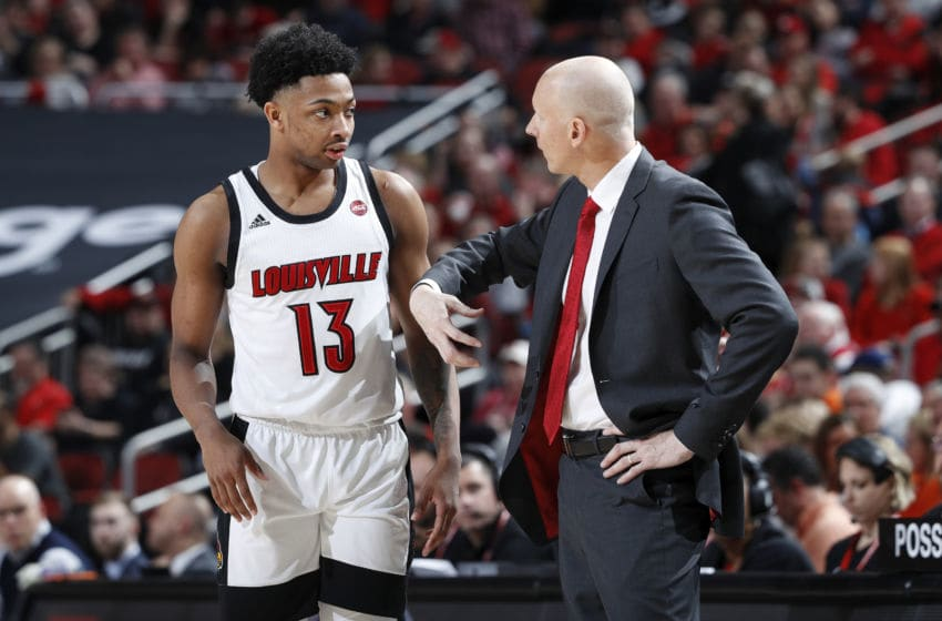 LOUISVILLE, KY - FEBRUARY 19: David Johnson #13 of the Louisville Cardinals listens to head coach Chris Mack during a game against the Syracuse Orange at KFC YUM! Center on February 19, 2020 in Louisville, Kentucky. Louisville defeated Syracuse 90-66. (Photo by Joe Robbins/Getty Images)