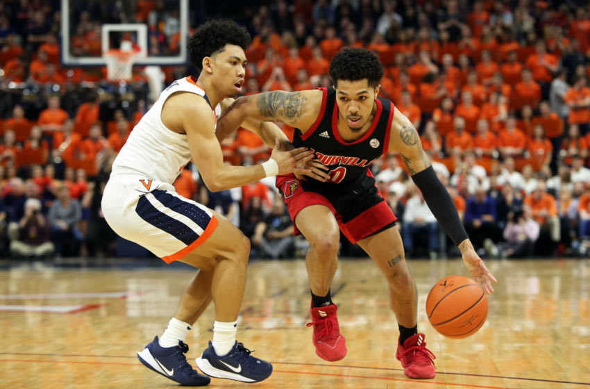 CHARLOTTESVILLE, VA - MARCH 07: Kihei Clark #0 of the Virginia Cavaliers defends Lamarr Kimble #0 of the Louisville Cardinals in the first half during a game at John Paul Jones Arena on March 7, 2020 in Charlottesville, Virginia. (Photo by Ryan M. Kelly/Getty Images)