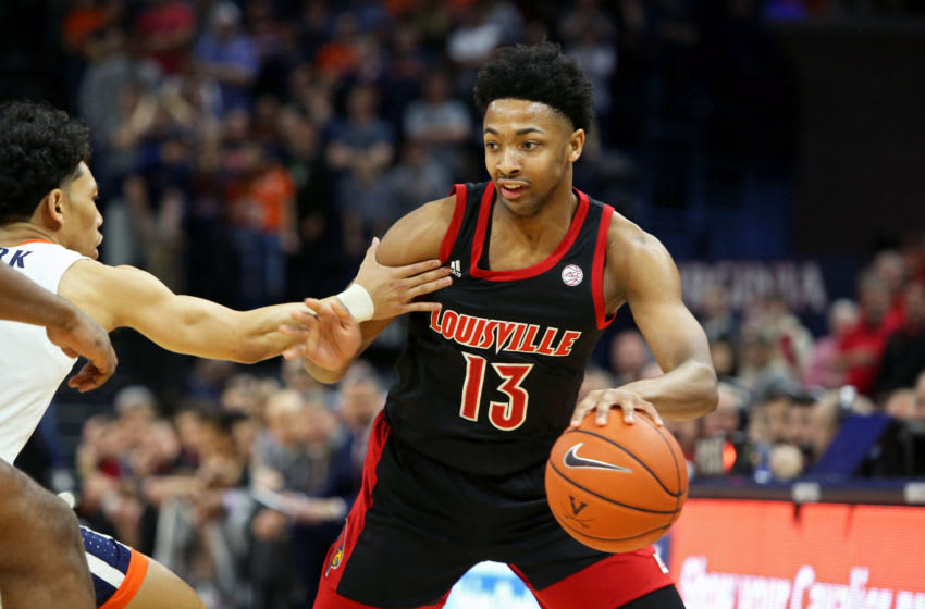 CHARLOTTESVILLE, VA - MARCH 07: David Johnson #13 of the Louisville Cardinals dribbles in the first half during a game against the Virginia Cavaliers at John Paul Jones Arena on March 7, 2020 in Charlottesville, Virginia. (Photo by Ryan M. Kelly/Getty Images)