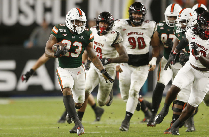 MIAMI, FLORIDA - NOVEMBER 09: Cam'Ron Harris #23 of the Miami Hurricanes runs with the ball against the Louisville Cardinals during the second half at Hard Rock Stadium on November 09, 2019 in Miami, Florida. (Photo by Michael Reaves/Getty Images)