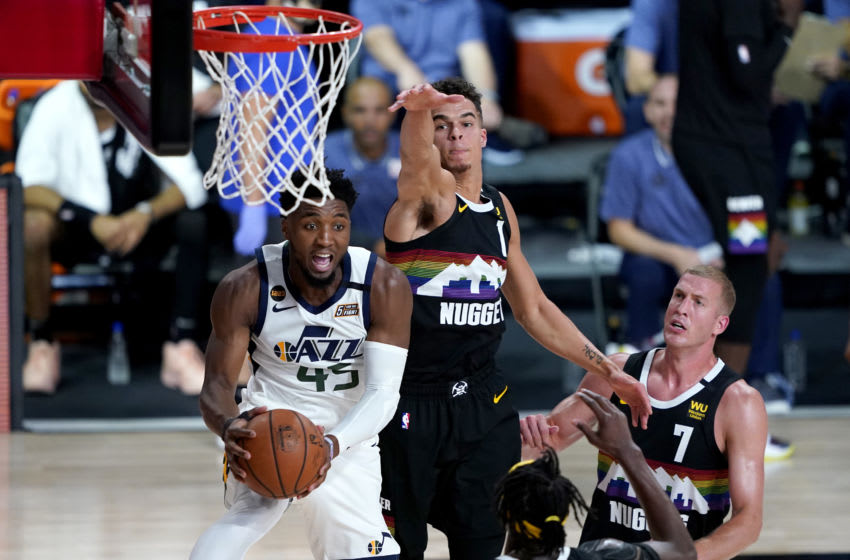 LAKE BUENA VISTA, FLORIDA - AUGUST 19: Donovan Mitchell #45 of the Utah Jazz looks to pass as Michael Porter Jr. #1 of the Denver Nuggets defends during the first half of Game Two of a first round playoff game at AdventHealth Arena at ESPN Wide World Of Sports Complex on August 19, 2020 in Lake Buena Vista, Florida. NOTE TO USER: User expressly acknowledges and agrees that, by downloading and or using this photograph, User is consenting to the terms and conditions of the Getty Images License Agreement. (Photo by Ashley Landis-Pool/Getty Images)
