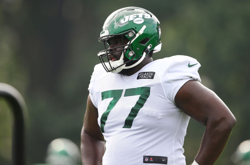 FLORHAM PARK, NEW JERSEY - AUGUST 23: Mekhi Becton #77 of the New York Jets runs drills at Atlantic Health Jets Training Center on August 23, 2020 in Florham Park, New Jersey. (Photo by Mike Stobe/Getty Images)