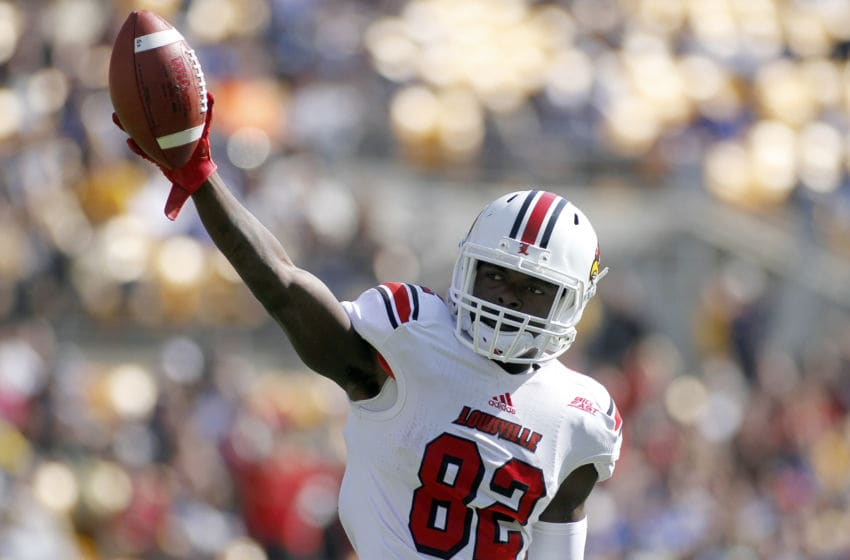PITTSBURGH, PA - OCTOBER 13: Eli Rogers #82 of the Louisville Cardinals celebrates after making a catch in the second half against the Pittsburgh Panthers during the game on October 13, 2012 at Heinz Field in Pittsburgh, Pennsylvania. The Cardinals defeated the Panthers 45-35. (Photo by Justin K. Aller/Getty Images)