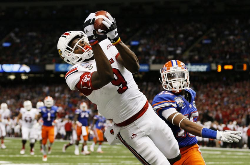 NEW ORLEANS, LA - JANUARY 02: DeVante Parker #9 of the Louisville Cardinals catches a second quarter touchdown pass over Loucheiz Purifoy #15 of the Florida Gators during the Allstate Sugar Bowl at Mercedes-Benz Superdome on January 2, 2013 in New Orleans, Louisiana. (Photo by Kevin C. Cox/Getty Images)